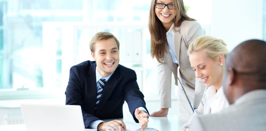 Portrait of happy businessman stretching arm towards his partner at meeting